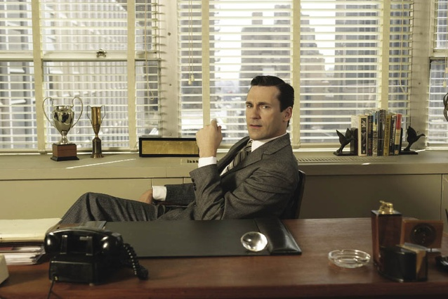 Don Draper (Jon Hamm) at his office desk in the TV show <em>Mad Men</em> (2007–).