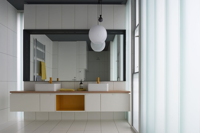 Touches of yellow are dotted throughout the house, such as the tapware seen in the upstairs bathroom – a response to the fact that yellow is a favourite colour of one family member.