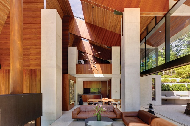 "A skylight in the high ceiling cuts the house in two along its longitudinal length, ""axing the space surprisingly and splitting a volume like a log."""