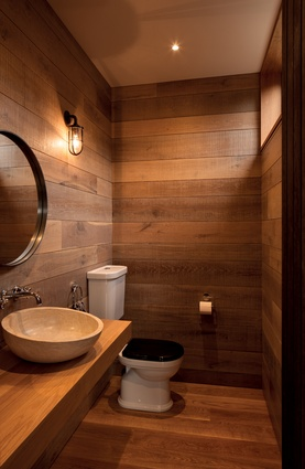 The bathroom is lined in raw-sawn timber.