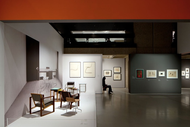 Furniture against Josef Albers photograph. Stacking tables, c. 1927 – ash veneer, black lacquer, wood and painted glass. Oeser House armchair, designed 1926, produced 1928 – mahogany, beech, maple.