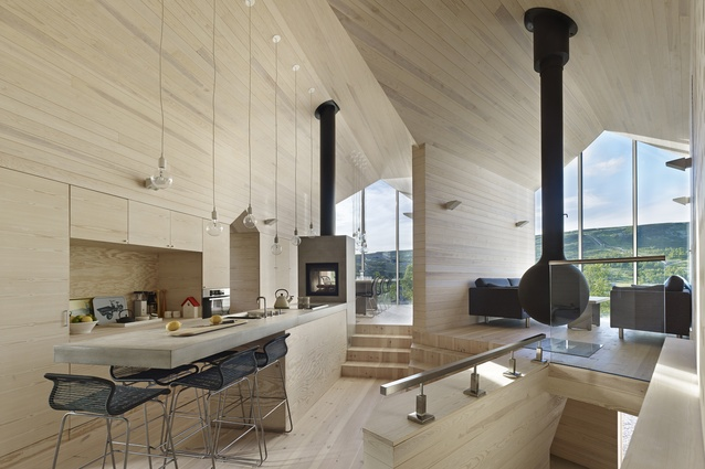 The kitchen acts as a central cog to the various areas of the cabin.