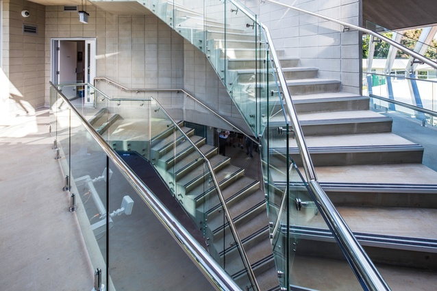 Access to the first floor and rooftop is at the centre of the building, via a helix staircase through an opening in the floor slab.