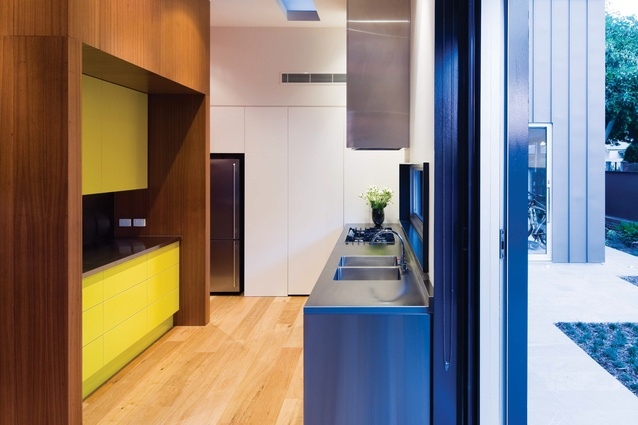 Bright hues contribute to the overall composition of the kitchen at Norwood Residence.