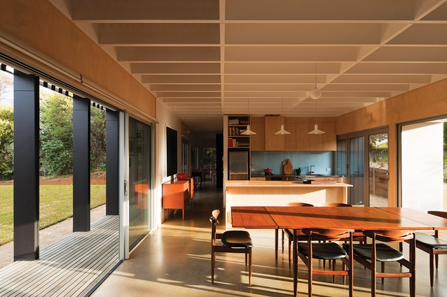 The open-planned kitchen/dining/living is open to the outside on both edges.