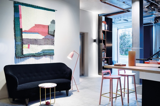 Alex Hotel features a variety of domestic-like settings with textiles, rugs and books. Artwork: Weaving by Ben Baretto.