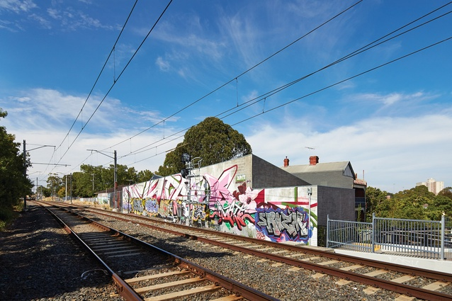 The railway side of the forty-metre block wall acts somewhat as a billboard and provides a canvas for street art.