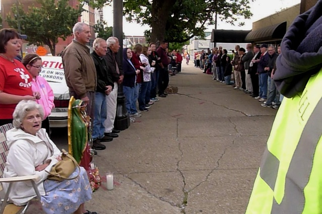 Pre-Easter anti-abortion protestors sidewalk queue in Louisville, Kentucky, April 2012.