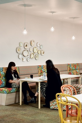 Colourful banquette seating in the café area.