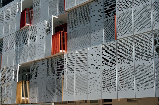 A new facade is made of perforated steel panels.