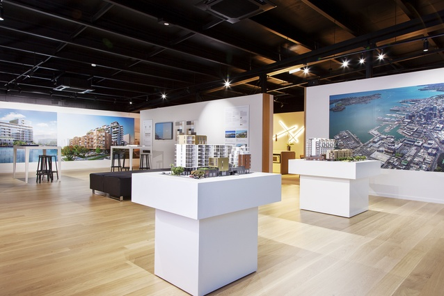 The interior of the display suite includes architectural models of the two buildings, and fully-furnished apartment sections