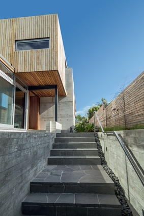 Cantilevered in several directions, both the upper and ground floors appear as a series of interconnected volumes pushed out and pulled up within the footprint of the house.