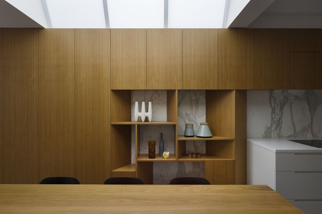 The timber joinery element defines space, hides services and provides display space.
