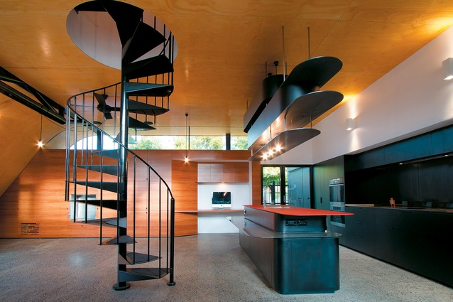 Steel plate adds a unique form and material to this large black kitchen. Hill House by Andrew Maynard Architects.