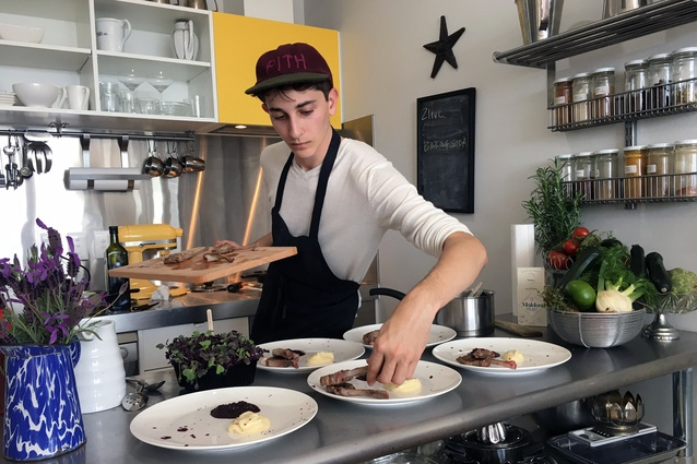 Young New York cook Jonah Reider dishes up some succulent New Zealand lamb at the pop-up Pith by Mini restaurant at Merchant Quarter, New Lynn.