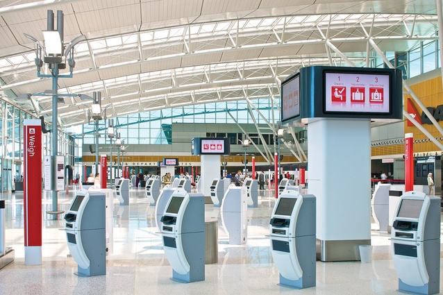 "Vince Frost worked with Marc Newson to design the new Qantas check-in area, the ""Next Generation Check-in."""