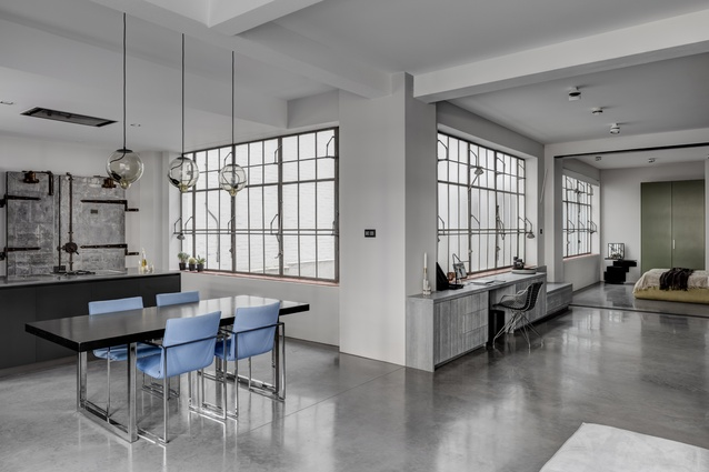 The architects retained the banks of original industrial windows, with their quarry-tile sills and pivoting hinge system.