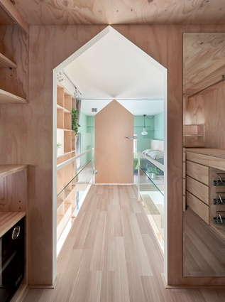 At a mere 40m<sup>2</sup>, this apartment uses clever storage and a mezzanine floor to comfortably house a family of three.