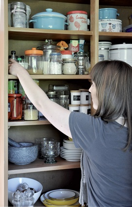 Open-style kitchen shelving suits the feel of the rest of the house.