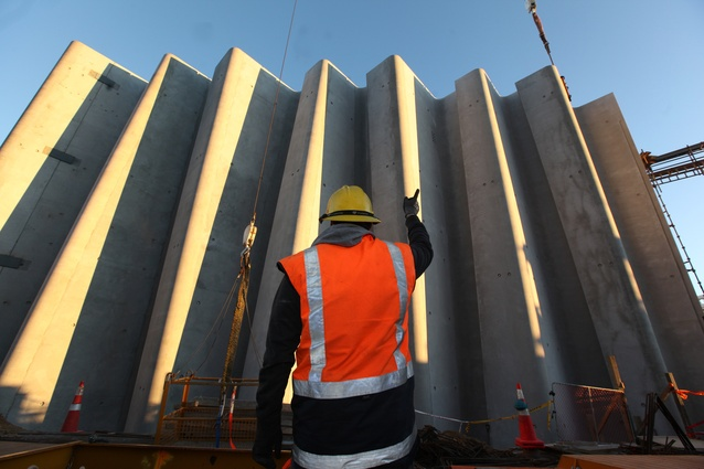 The façade panels are 14 meters high are weigh 35 tonnes each.
