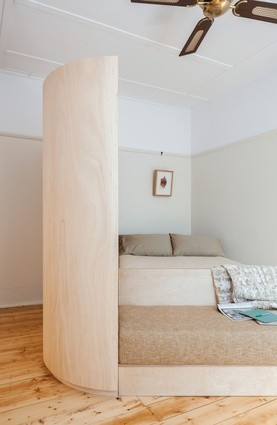 The curve of the joinery was inspired by an art deco fitting formerly in the apartment.