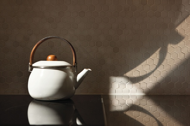 Hexagonal tiles create a textural splashback for the kettle to pose in front of.