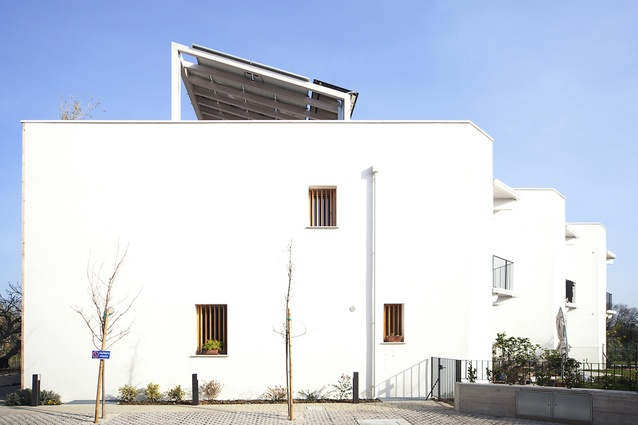 Straw bale townhouses in Fano, Italy by Archética, 2015.