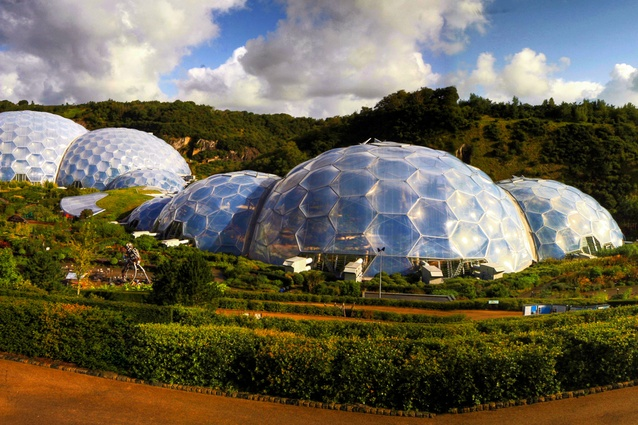 Eden Project, Cornwall, UK by Grimshaw Architects. The biomes' cladding is made of triple-layered pillows of ETFE foil. Structurally, each dome is a hex-tri-hex space frame reliant on two layers.