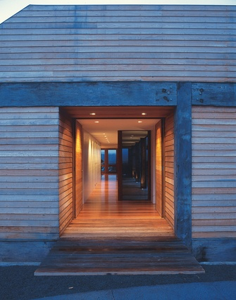The home is made almost entirely from reclaimed timber, including the posts and beams, which were salvaged from a demolished bridge.