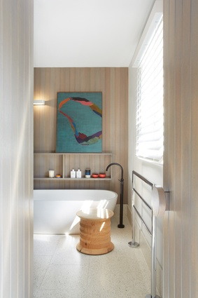 Soft hues and textures are used in the main ensuite. Artwork: Belem Lett.