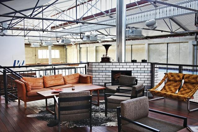 The cozy mezzanine level has a fireplace.