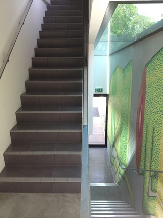 The building's staircase with graffiti art applied.