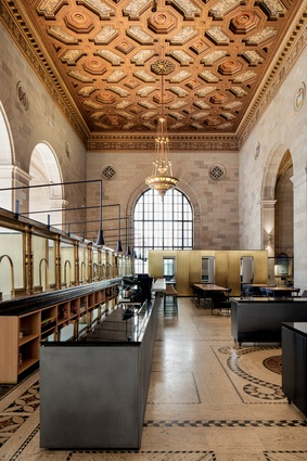 The building boasts an opulent stucco ceiling, copious solid-brass fixtures and enormous arched windows.
