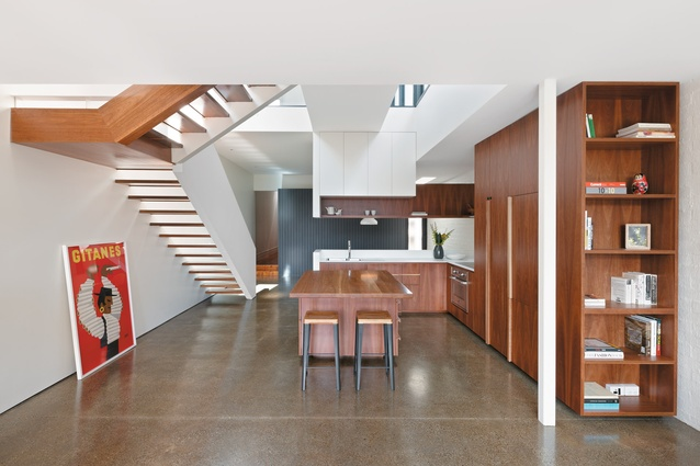 The kitchen contains spotted-gum veneer kitchen cabinetry with retro-styled, moulded handles.