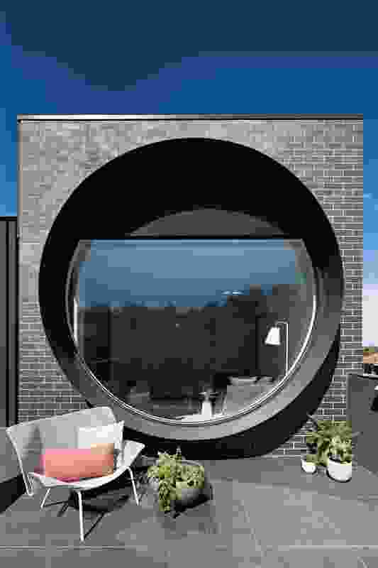 "The porthole windows connect with the street, mask the building's bulk and give a nod to ""architectural heroes"" Kisho Kurokawa and Louis Kahn."