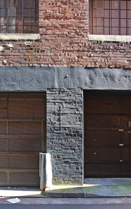 Common and cut bricks and perfunctory concrete sills in the 'sides and backs' of the city.
