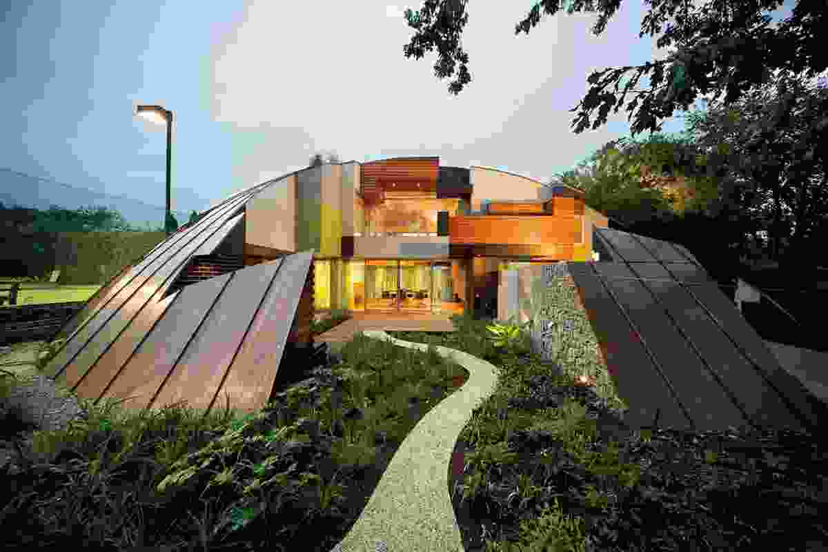 Dome House by McBride Charles Ryan resembles an incomplete 3-D puzzle.