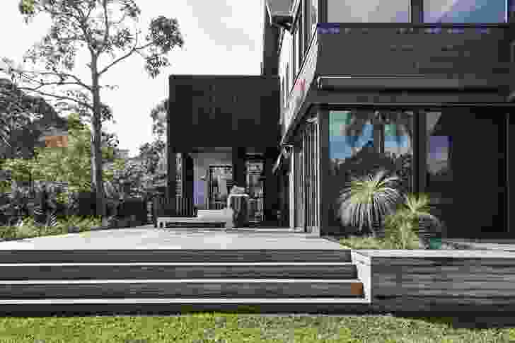 """With its dark palette and small footprint, the project reads as a """"black stealth addition."""""""