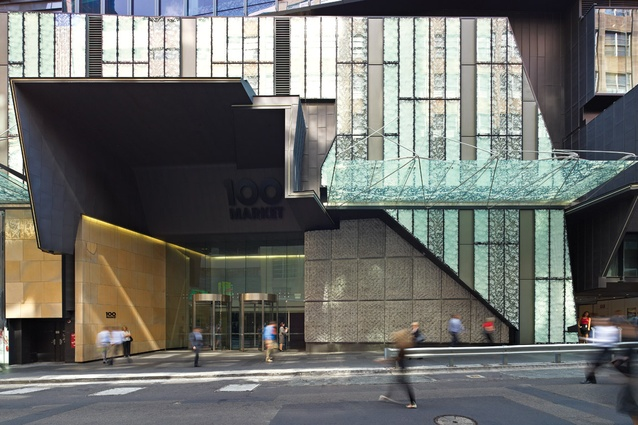 Entry from 100 Market Street showing patterned glass facade and woven rope concrete installation by Dani Marti.