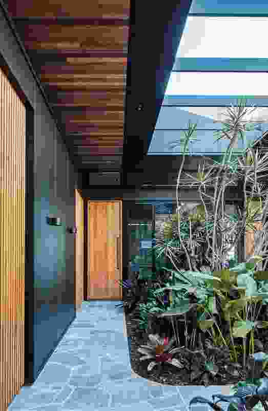 The home's sequence of internal gardens and courtyards is a nod to tropical modernism.