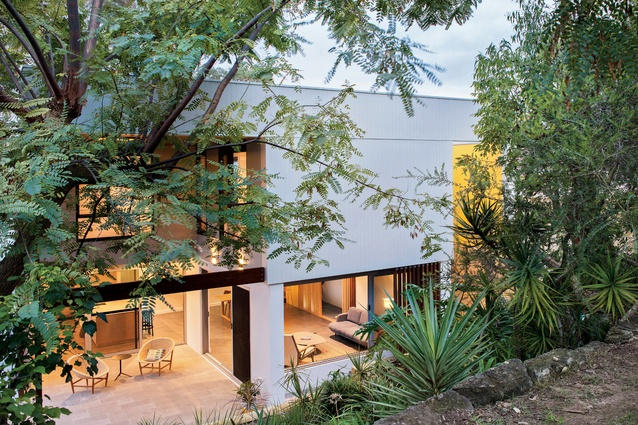 The mid-century modern-inspired Calais Road House features several recesses carved into its solid form.
