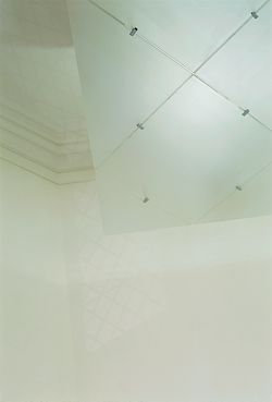 A detail of the suspended glass ceiling panel, which conceals contemporary services and remedial structural works.