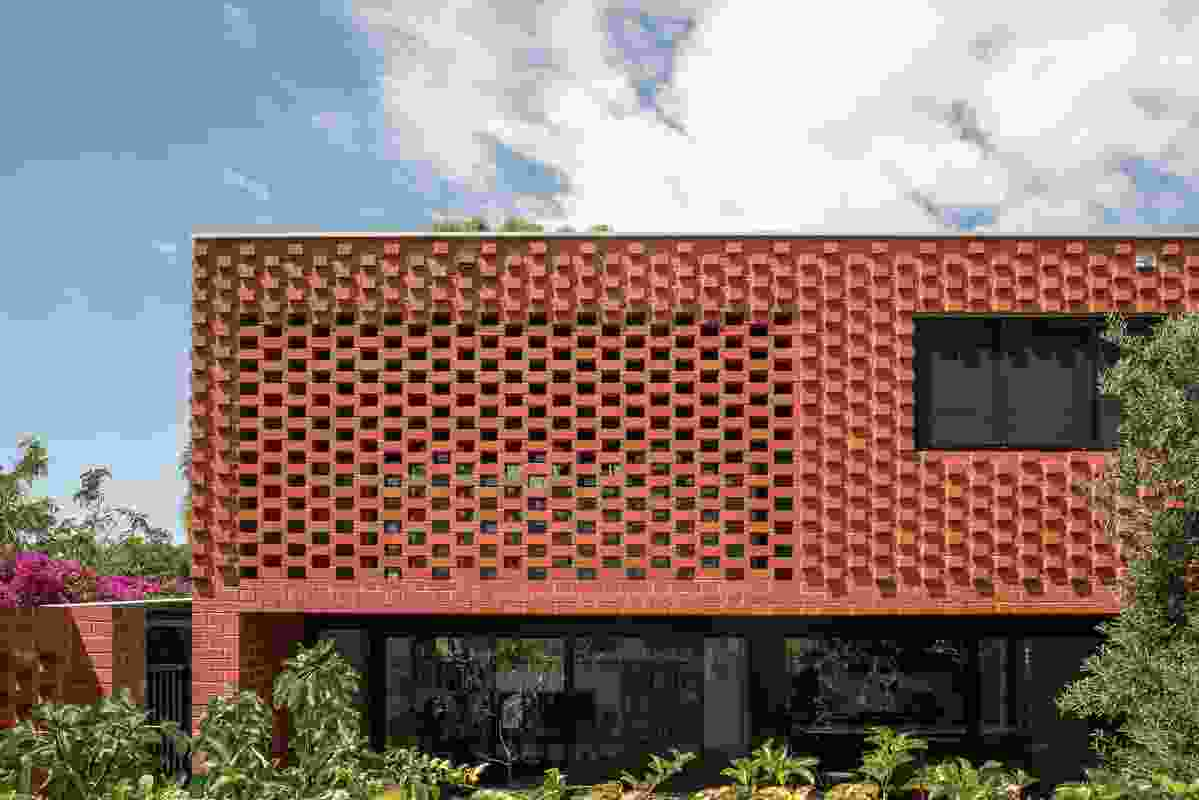 A contemporary twist on traditional Flemish bond brickwork makes for a highly textured facade.