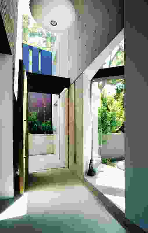 The skylit entry looks into a sheltered rear courtyard.