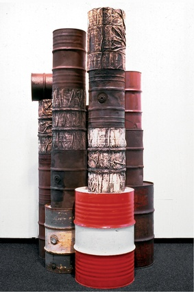 Wrapped Oil Barrels, 1958–1959, by Christo.