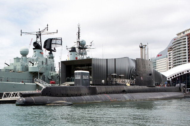 The new pavilion sits between two moored retired naval vessels, the destroyer HMAS Vampire and the submarine HMAS Onslow.