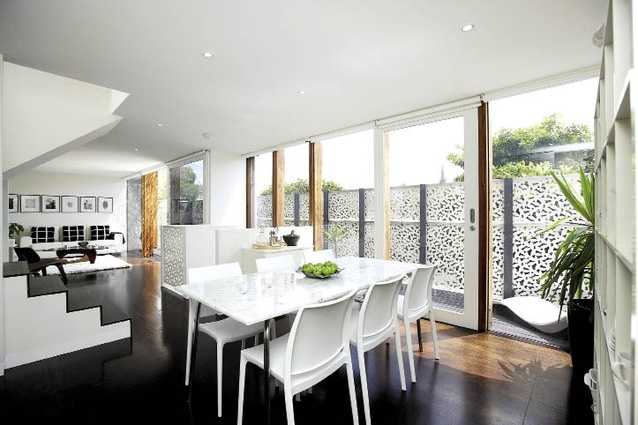 The living area on the middle level is light and airy, cleverly making a tight space feel open.