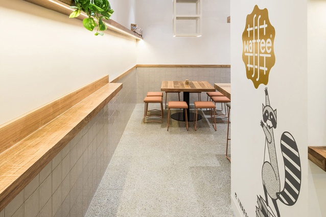 Natural timbers and Earth Honed terrazzo tiles in Waffee cafe.