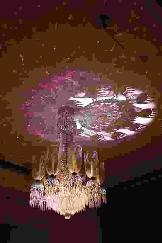 Splinter Garden DVD loop projected through nineteenth-century English chandelier in the drawing room.