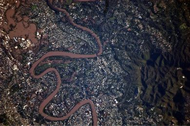 An aerial image of a partially-inundated Brisbane taken from the International Space Station during the 2011 floods that affected Queensland.